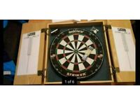 Dartboard as new in cabinet boxed with darts dart board in Calverton Nottingham