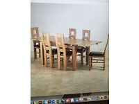 OAK FURNITURELAND Dining Room Table and 6 chairs