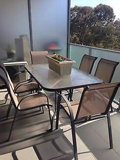 Outdoor setting with table and six chairs in good condition