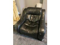 Black Leather ArmChair with small rip in it