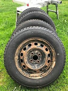 set of 185-70-14 Studded tires on rims