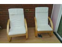 Two very comfortable cream armchairs