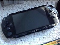 psp 1000 with 4gb memory & 200 games