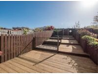 Stunning two double bedroom terrace villa with fabulous sun-deck garden and garage