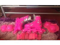 Pink inline skates and pads