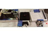 PlayStation 4 slim 1TB + 4 Games