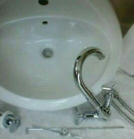 White ceramic basin, mixer tap and waste