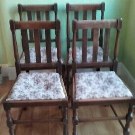Four solid oak dining chairs