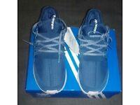 BRAND NEW UNWORN Adidas tubular radial trainers size 7