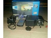 Mini projector complete with remote and charger