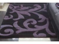 Black and purple medium rug