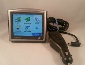 TOMTOM ONE 2ND EDITION WITH UK MAPS. GOOD CONDITION AND WORKS PERFECTLY. INCLUDES ORIGINAL CHARGER