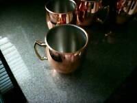 4 unused Copper plated mugs