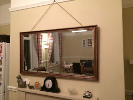 Large Mirror with dark brown wood and golden accents