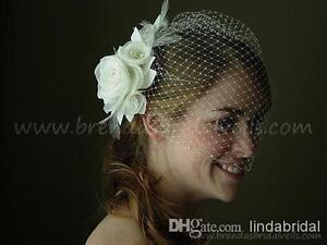 Wedding flower for hair with attached netting