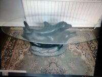 Oval glass coffee table. with featured Dolphins. supporting glass £25.00