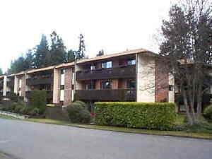 Best location in Qualicum Beach Two bedroom, one bathroom condo