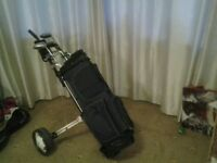 11 Golf clubs and trolley, mix of Dunlop, Wilson &Hippo