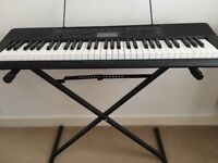 Never-used Casio CTK2300 keyboard with stand