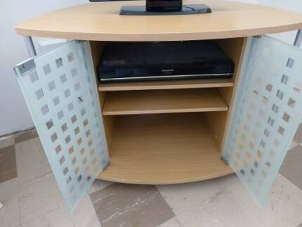 TV cabinet with wheels and glass doors, 2 shelves, very good cond