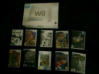 *GOOD CONDITION, BOXED WITH ORIGINAL ACCESSORIES* Nintendo Wii console with 10 games.