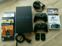 PS2+5 games+ 2 cordless controllers(bought 2 months ago'and used only few times)