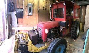 1959 4-Cylinder Disel Tractor, with snow plow, and blower.