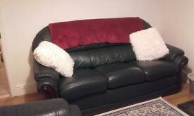 Great Condition leather sofa, chair & foot stool with storage. No longer required.