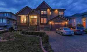 Immaculate 6 Bedroom and 5 Bath Custom Built Home