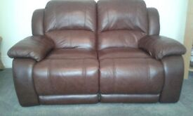 2 X Leather reclining sofas. Dark brown. Both recline. 2 seater and 3 seater. A1 condition