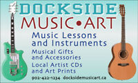 Thinking about guitar lessons? Need an  easy- playing guitar?