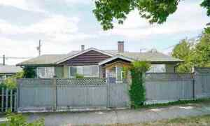 Charming One Level Rancher With Back Lane Access
