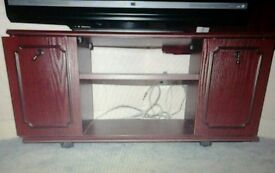 Wooden tv stand with sliding doors