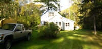 1 acre lot with house and garage for $125,000