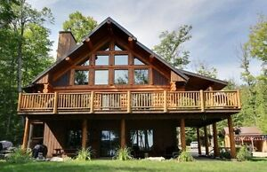 Waterfront log home for sale on Lac Notre-Dame in La Pêche.