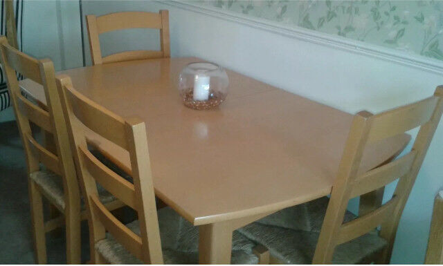 beech laminated table and four chairs