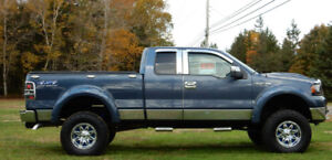 2005 Ford F-150 with 6'' lift kit....almost $13,000.00 extras on