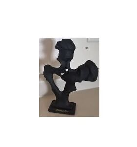 Black Wood Sculpture of a Man and Woman Kissing