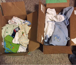 2 boxes full of sleepers. Newborn- 6 months