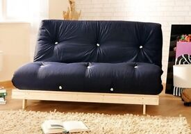 This handmade mattress futon features a dual usage as either a bed or folded up into a sofa.