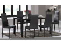 Black glass top dining table and six chairs