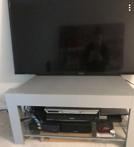 SOLID SILVER TV STAND with two glass shelves underneath