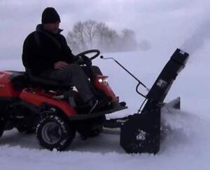 Husqvarna  AWD Rider with Snowblower Attachment. Very Versatile!