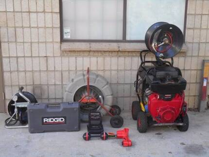 Drain cleaning water jetter and locator camera combination