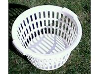 Laundry basket and 130 pegs
