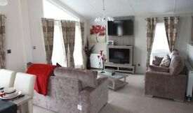 For sale cheap lodge holiday home with huge decking & sea & countryside views! Amazing value!
