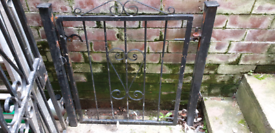 Wrought iron garden gate and posts.