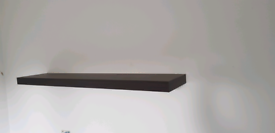 2x deep brown floating shelves and brackets