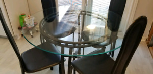 Glass dining room table with Black Chairs