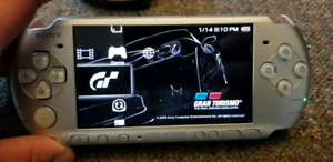 Sony PSP console with games and accessories